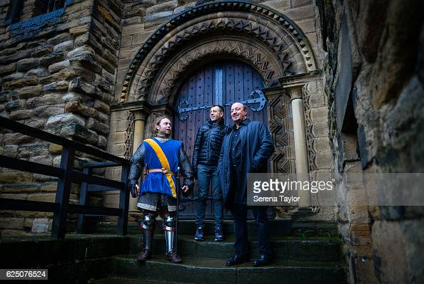 Newcastle Manager Rafael Benitez stands on the top of the steps to the Castle Keep with a swordsman and Newcastle United's Assistant Manager...