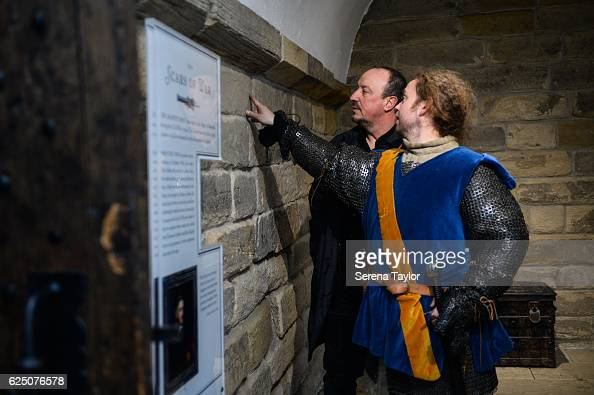 Newcastle Manager Rafael Benitez talks with a tour guide dressed as a swordsman on at the Castle Keep during a visit to landmarks in the North East...