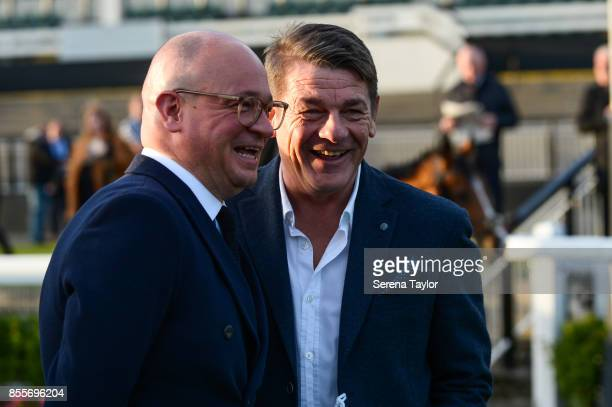 Newcastle Managing Director Lee Charnley and John Carver laugh during the 125 Plate at the Newcastle Race Course on September 29 in Newcastle upon...