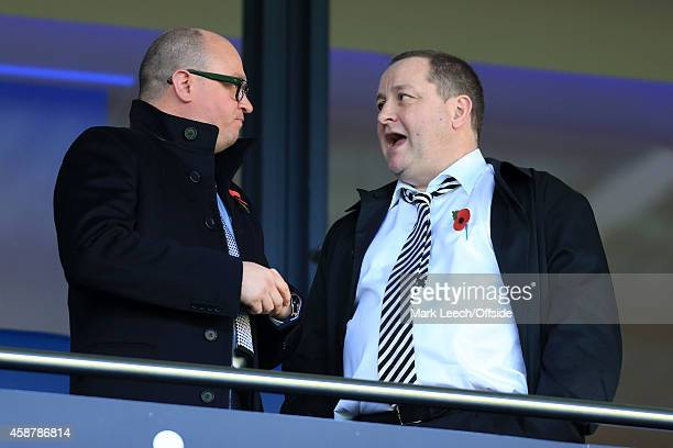 Newcastle owner Mike Ashley speaks to Managing Director Lee Charnley during the Barclays Premier League match between West Bromwich Albion and...