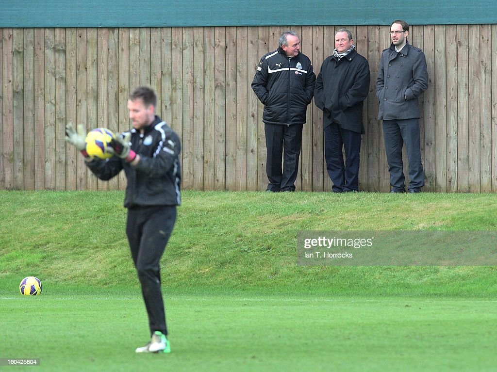 Newcastle owner Mike Ashley (center) with Dereck Llambias, managing director (left) and John Irving, financial director (right) during a Newcastle United training session at The Little Benton training ground on January 31, 2013 in Birmingham, England.