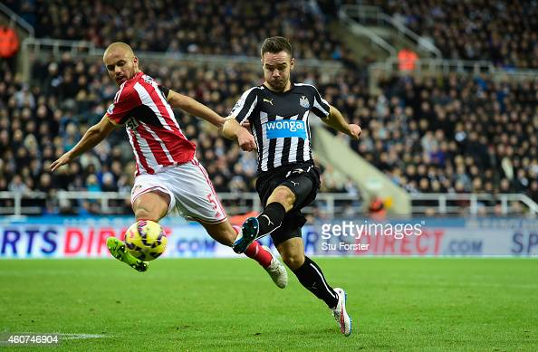 Newcastle player Adam Armstrong gets in a shot despite the attentions of Wes Brown of Sunderland during the Barclays Premier League match between...
