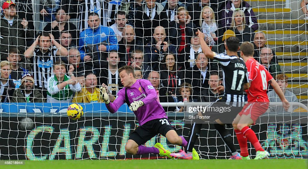 Newcastle player Ayoze Perez fires the opening goal past Simon Mignolet during the Barclays Premier League match between Newcastle United and...