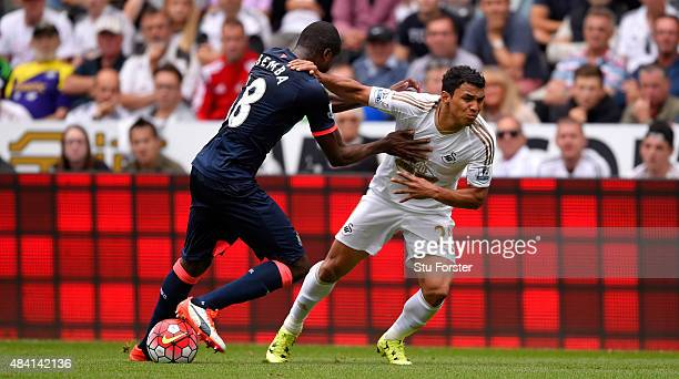 Newcastle player Chancel Mbemba is beaten by Jefferson Montero to the ball during the Barclays Premier League match between Swansea City and...