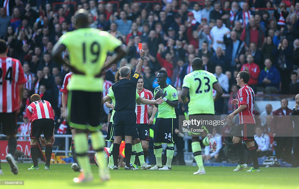Newcastle player Cheick Tiote (c) is shown the red card by referee Martin Atkinson during the Barclays Premier league match between Sunderland and Newcastle United at Stadium of Light on October 21, 2012 in Sunderland, England.