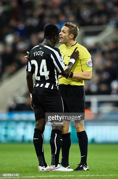 Newcastle player Chieck Tiote has words with referee Craig Pawson during the Barclays Premier League match between Newcastle United and Everton at St...