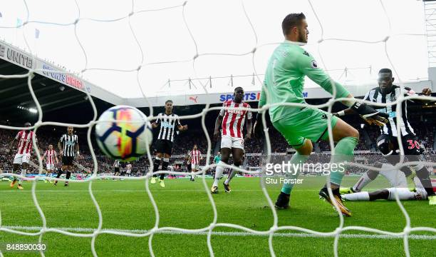 Newcastle player Christian Atsu scores the opening goal past Jack Butland during the Premier League match between Newcastle United and Stoke City at...