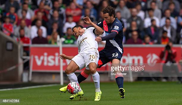 Newcastle player Daryl Janmaat fouls Jefferson Montero of Swabnsea during the Barclays Premier League match between Swansea City and Newcastle United...