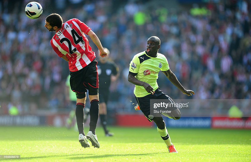 Newcastle player Demba Ba (r) and Carlos Cuellar compete for a loose ball during the Barclays Premier league match between Sunderland and Newcastle United at Stadium of Light on October 21, 2012 in Sunderland, England.