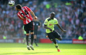 Newcastle player Demba Ba and Carlos Cuellar compete for a loose ball during the Barclays Premier league match between Sunderland and Newcastle...