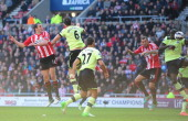 Newcastle player Demba Ba deflects the ball for Sunderlands equaliser from a John O' Shea header during the Barclays Premier league match between...