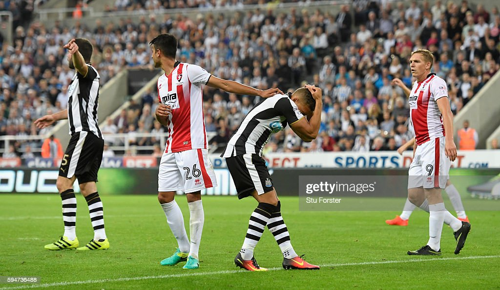 Newcastle player Dwight Gayle (2nd r) reacts after clashing heads during the EFL Cup Round Two match between Newcastle United and Cheltenham Town at St. James Park on August 23, 2016 in Newcastle upon Tyne, England.