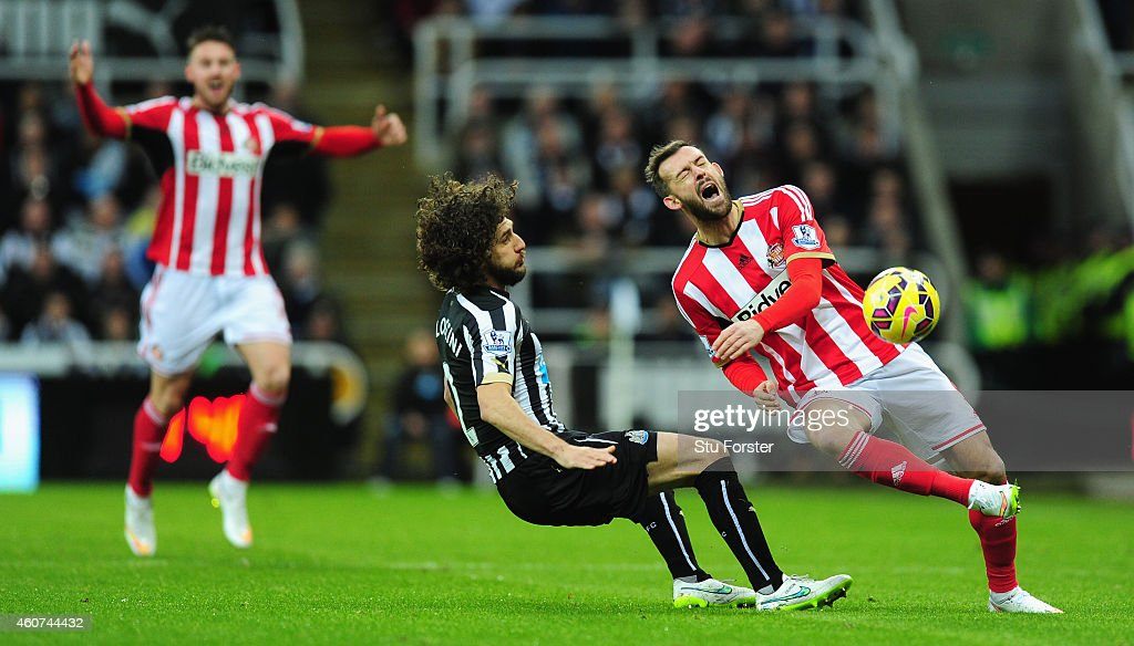 Newcastle player Fabricio Coloccini fouls Steven Fletcher of Sunderland during the Barclays Premier League match between Newcastle United and...