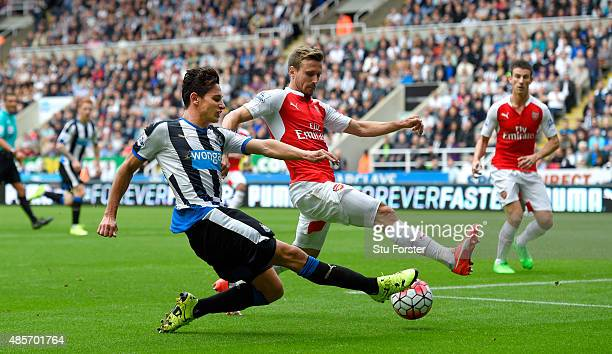 Newcastle player Florian Thauvin has his shot blocked by Arsenal defender Nacho Monreal during the Barclays Premier League match between Newcastle...