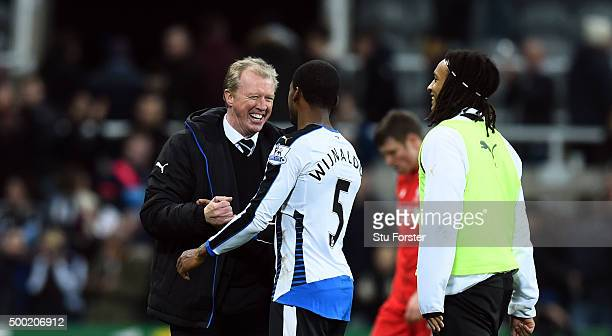 Newcastle player Georginio Wijnaldum is congratulated by manager Steve McClaren after the Barclays Premier League match between Newcastle United and...