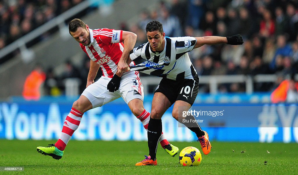 Newcastle player <a gi-track='captionPersonalityLinkClicked' href=/galleries/search?phrase=Hatem+Ben+Arfa&family=editorial&specificpeople=825038 ng-click='$event.stopPropagation()'>Hatem Ben Arfa</a> (r) tangles with Erik Peters during the Barclays Premier League match between Newcastle United and Stoke City at St James' Park on December 26, 2013 in Newcastle upon Tyne, England.