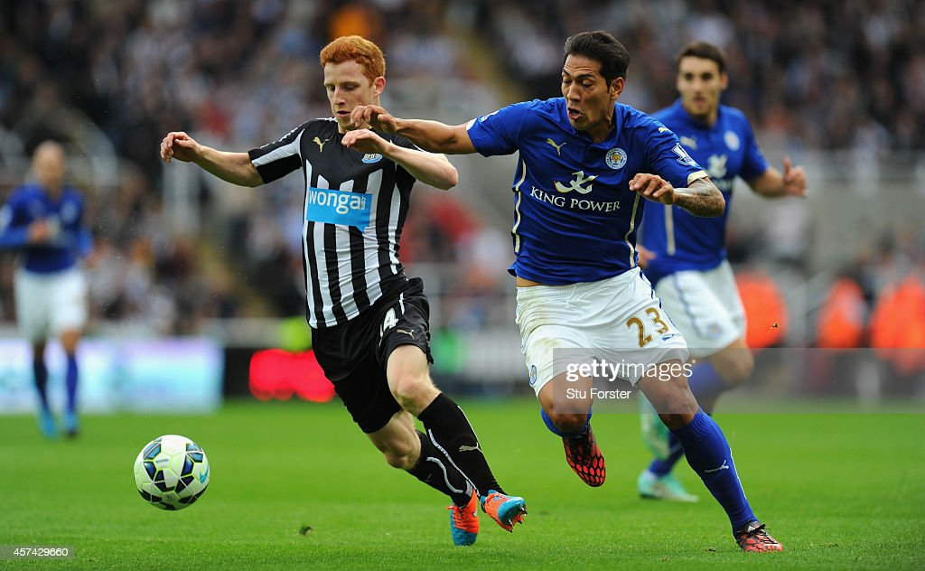 Newcastle player Jack Colback (l) challenges Leonardo Ulloa of Leicester during the Barclays Premier League match between Newcastle United and Leicester City at St James' Park on October 18, 2014 in Newcastle upon Tyne, England.