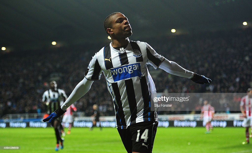 Newcastle player Loic Remy celebrates after scoring the third goal during the Barclays Premier League match between Newcastle United and Stoke City at St James' Park on December 26, 2013 in Newcastle upon Tyne, England.