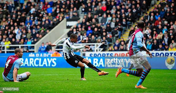 Newcastle player Loic Remy scores the winning goal during the Barclays Premier League match between Newcastle United and Aston Villa at St James'...