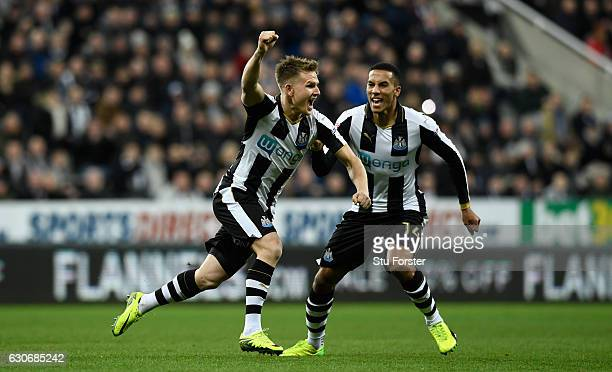 Newcastle player Matt Ritchie celebrates his opening goal with Isaac Hayden during the Sky Bet Championship match between Newcastle United and...