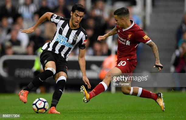 Newcastle player Mikel Merino is challenged by Phillipe Coutinho of Liverpool during the Premier League match between Newcastle United and Liverpool...