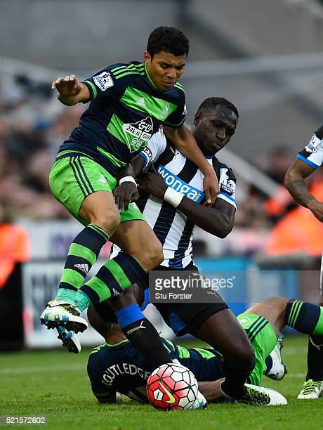Newcastle player Moussa Sissoko challenges Jefferson Montero of Swansea during the Barclays Premier League match between Newcastle United and Swansea...
