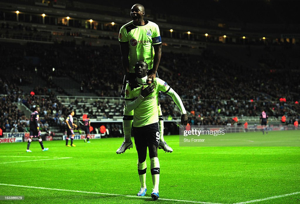 Newcastle player <a gi-track='captionPersonalityLinkClicked' href=/galleries/search?phrase=Papiss+Cisse&family=editorial&specificpeople=4251917 ng-click='$event.stopPropagation()'>Papiss Cisse</a> (front) and <a gi-track='captionPersonalityLinkClicked' href=/galleries/search?phrase=Shola+Ameobi&family=editorial&specificpeople=211410 ng-click='$event.stopPropagation()'>Shola Ameobi</a> celebrate the third Newcastle goal during the UEFA Europa League match between Newcastle United and FC Girondins de Bordeaux at Sports Direct Arena on October 4, 2012 in Newcastle upon Tyne, England.