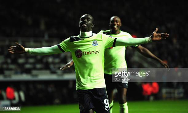 Newcastle player Papiss Cisse and Shola Ameobi celebrate the third Newcastle goal during the UEFA Europa League match between Newcastle United and FC...