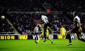 Newcastle player Papiss Cisse heads the winning goal during the UEFA Europa League Round of 16 second leg match between Newcastle United FC and FC...