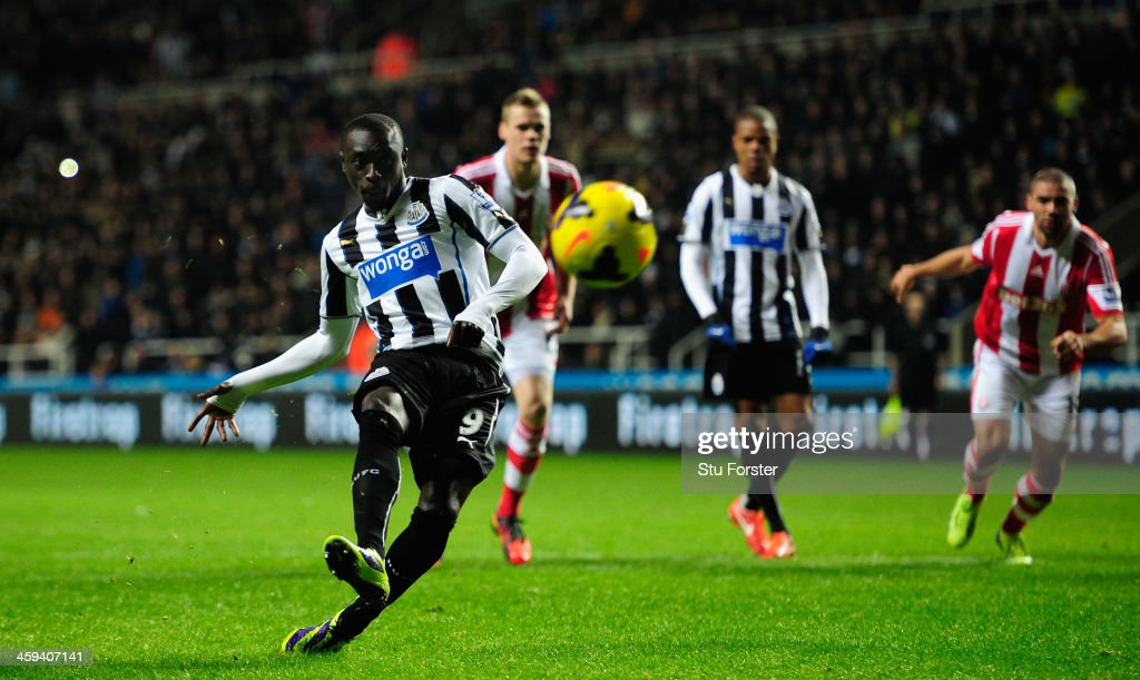 Newcastle player Papiss Cisse tucks the fifth goal away ftrom the Penalty spot during the Barclays Premier League match between Newcastle United and Stoke City at St James' Park on December 26, 2013 in Newcastle upon Tyne, England.