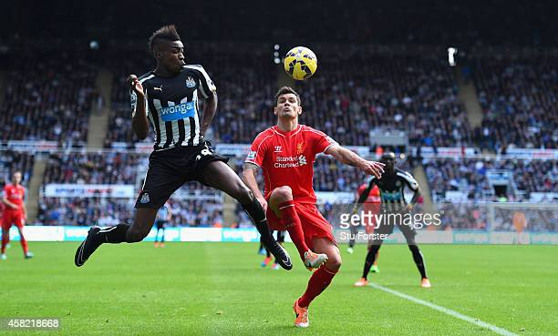 Newcastle player Sammy Ameobi challenges Dejan Lovren during the Barclays Premier League match between Newcastle United and Liverpool at St James'...