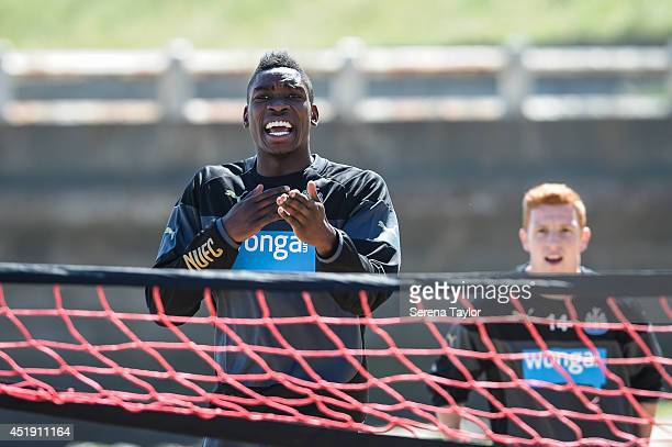 Newcastle player Sammy Ameobi reacts during a Newcastle United Training Session at the Longsands beach in Tynemouth on July 09 in Newcastle upon Tyne...
