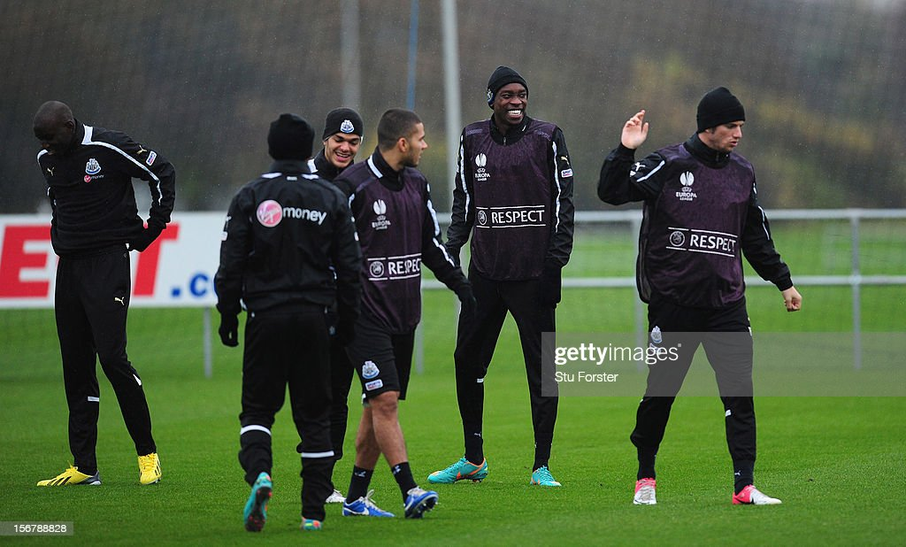 Newcastle player Sammy Ameobi (2nd R) shares a joke with team mates during Newcastle United training ahead of thursday's UEFA Europa League match against Maritimo at The Little Benton training ground on November 21, 2012 in Newcastle upon Tyne, England.