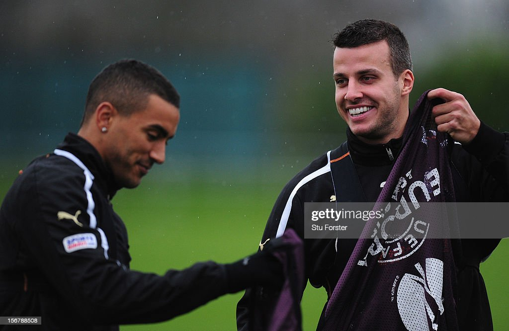Newcastle player Steven Taylor (r) shares a joke with Danny Simpson during Newcastle United training ahead of thursday's UEFA Europa League match against Maritimo at The Little Benton training ground on November 21, 2012 in Newcastle upon Tyne, England.