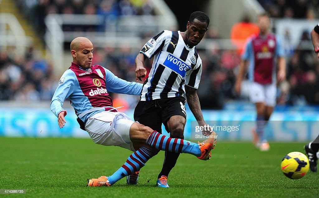 Newcastle player Vernon Anita (R) challenges Karim El Ahmadi of Aston Villa during the Barclays Premier League match between Newcastle United and Aston Villa at St James' Park on February 23, 2014 in Newcastle upon Tyne, England.