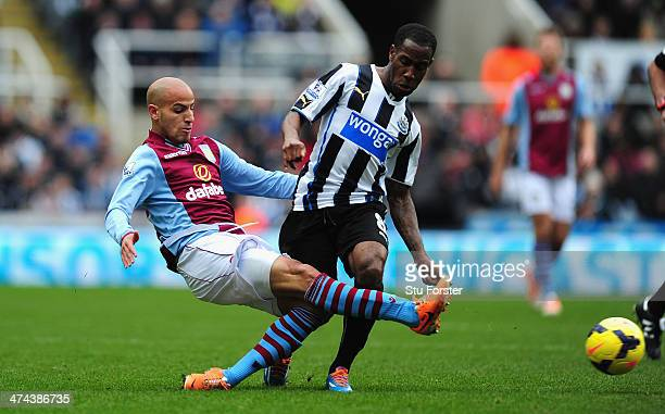 Newcastle player Vernon Anita challenges Karim El Ahmadi of Aston Villa during the Barclays Premier League match between Newcastle United and Aston...