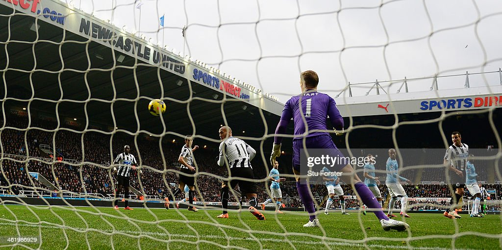 Newcastle player <a gi-track='captionPersonalityLinkClicked' href=/galleries/search?phrase=Yoan+Gouffran&family=editorial&specificpeople=534470 ng-click='$event.stopPropagation()'>Yoan Gouffran</a> (l) deflects a shot by Cheick Tiote (not pictured) into the City goal past <a gi-track='captionPersonalityLinkClicked' href=/galleries/search?phrase=Joe+Hart&family=editorial&specificpeople=1295472 ng-click='$event.stopPropagation()'>Joe Hart</a> but the 'goal' is dissalowed during the Barclays Premier League match between Newcastle United and Manchester City at St James' Park on January 12, 2014 in Newcastle upon Tyne, England.