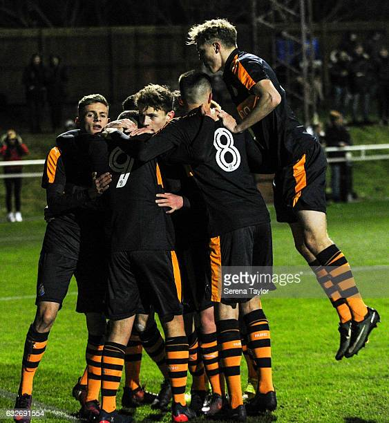 Newcastle players celebrate after Lewis McCall scored the opening goal from the penalty spot during the Fifth round of the FA Youth Cup match between...