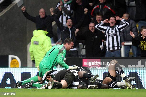 Newcastle players celebrate Cheik Tiote scoring the equalizing goal during the Barclays Premier league match between Newcastle United and Arsenal at...