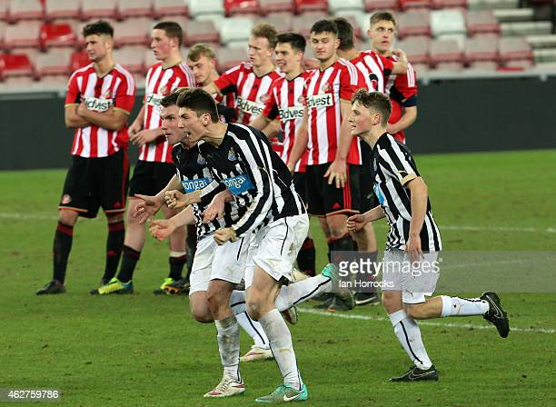 Newcastle players celebrate in the foreground after they won a penalty shoot out during the FA Youth Cup match between Sunderland U18 and Newcastle...