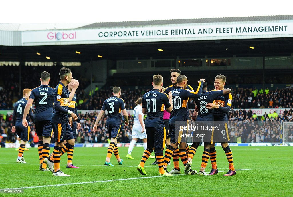Newcastle players celebrate with Dwight Gayle (R) after he scored Newcastle's second goal during the Sky Bet Championship Match between Leeds United and Newcastle United at Elland Road on November 20, 2016 in London, England.