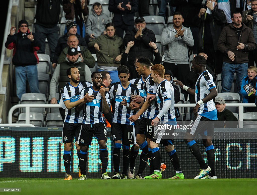 Newcastle players celebrate with Vurnon Anita (second from left) after he scores the second and equalising goal during the Barclays Premier League match between Newcastle United and Manchester City at St.James' Park on April 19, 2016, in Newcastle upon Tyne, England.