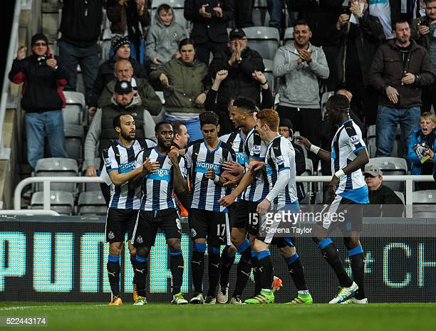 Newcastle players celebrate with Vurnon Anita after he scores the second and equalising goal during the Barclays Premier League match between...