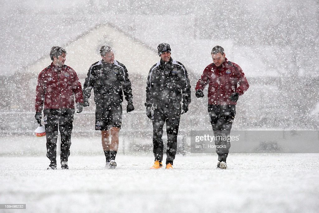 Newcastle players Dan Gosling (C, L) and Ryan Taylor with fitness staff Michael Harding (L) and Jamie Harley (R) walk in the snow during Newcastle United training session at the Little Benton Training Ground on January 14, 2013 in Newcastle upon Tyne, England.