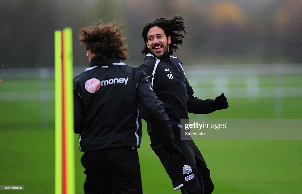 Newcastle players <a gi-track='captionPersonalityLinkClicked' href=/galleries/search?phrase=Fabricio+Coloccini&family=editorial&specificpeople=469707 ng-click='$event.stopPropagation()'>Fabricio Coloccini</a> (l) and Jonas Gutierrez share a joke during Newcastle United training ahead of thursday's UEFA Europa League match against Maritimo at The Little Benton training ground on November 21, 2012 in Newcastle upon Tyne, England.