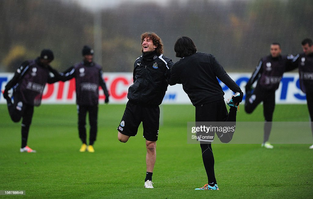Newcastle players Fabricio Coloccini (l) and Jonas Gutierrez share a joke during Newcastle United training ahead of thursday's UEFA Europa League match against Maritimo at The Little Benton training ground on November 21, 2012 in Newcastle upon Tyne, England.