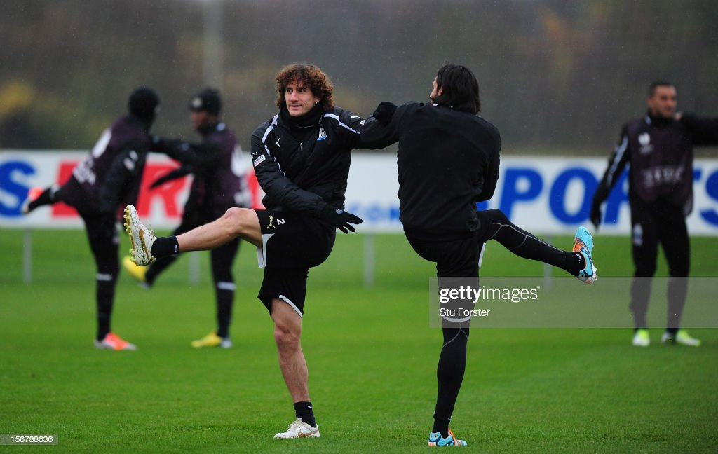 Newcastle players Fabricio Coloccini (l) and Jonas Gutierrez warm up during Newcastle United training ahead of thursday's UEFA Europa League match against Maritimo at The Little Benton training ground on November 21, 2012 in Newcastle upon Tyne, England.