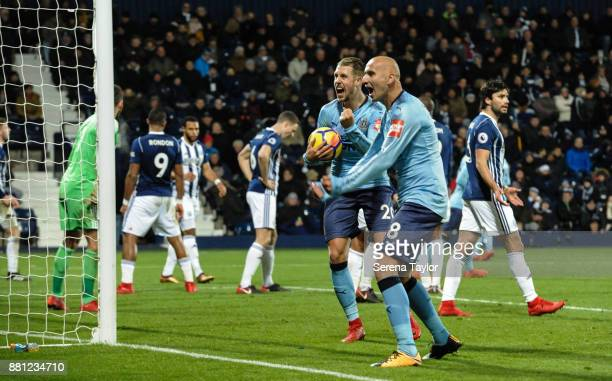 Newcastle players Florian Lejeune and Jonjo Shelvey Celebrate after Jonny Evans of West Bromwich Albion scores an own goal during the Premier League...