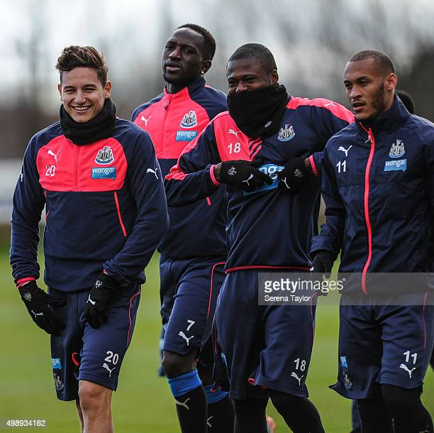 Newcastle players Florian Thauvin Moussa Sissoko Chancel Mbemba and Yoan Gouffran walk on the pitch during the Newcastle United Training session at...