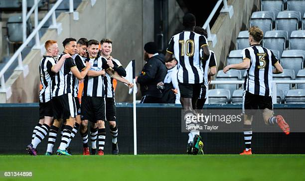 Newcastle players gather around Lewis McNall of Newcastle United after he scores Newcastle's first goal from the penalty spot during the FA Youth Cup...